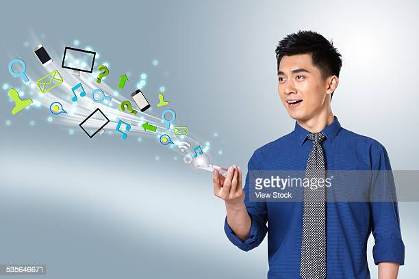 Young businessman with phone model