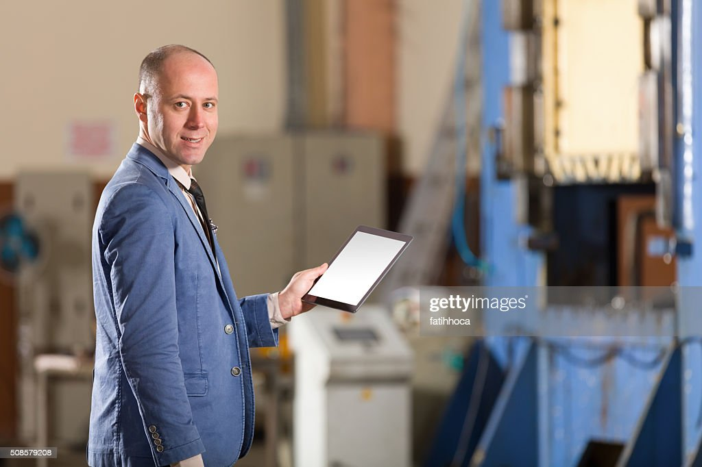 Young Businessman with Tablet : Stockfoto