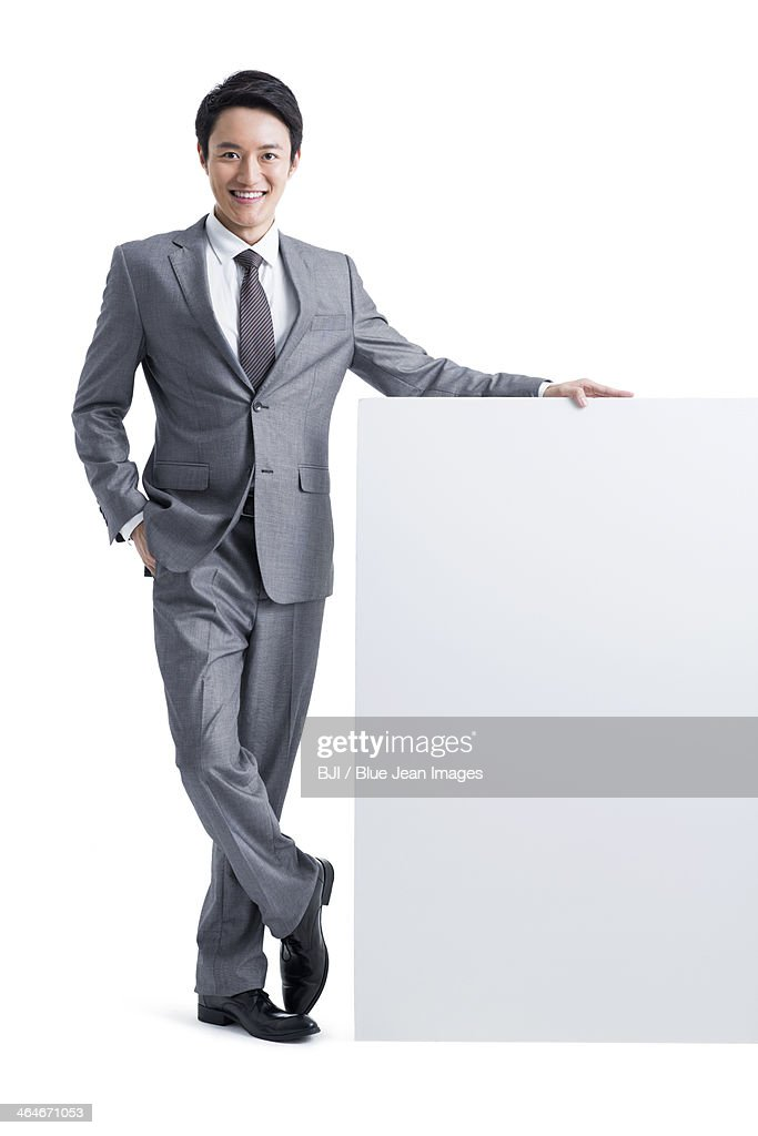 Young businessman with whiteboard : Stock Photo