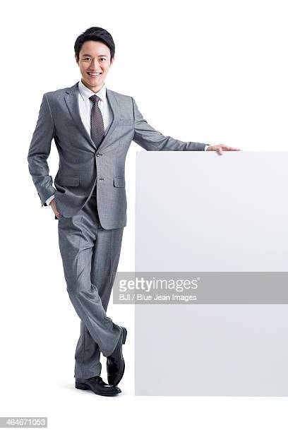 Young businessman with whiteboard