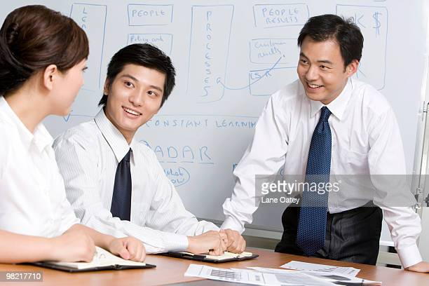 Young businessmen have meeting in office