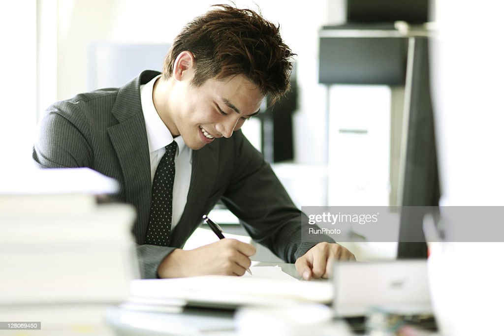 young businessmen working in the office : Stock Photo