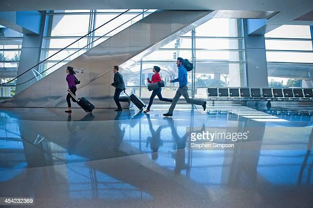 young businessmen/women rushing through airport