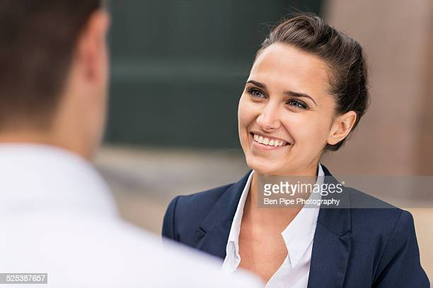 Young businesswoman and man chatting, London, UK
