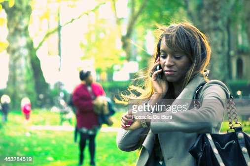 Young Businesswoman Checking Time And Making A Call