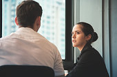 Young businesswoman discussing with businessman at office. Teamwork, brainstorming concept.