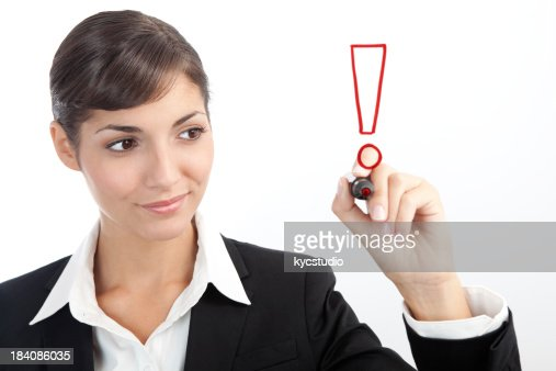 Young Businesswoman drawing an exclamation mark