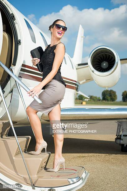 Young businesswoman entering private jet airplane