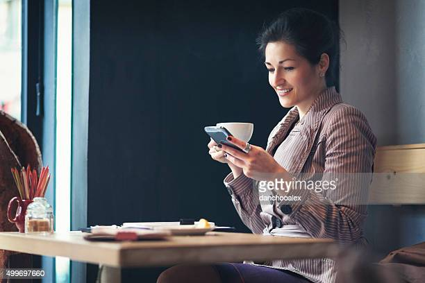 Young businesswoman having a coffee break