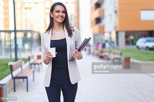 Young businesswoman having a coffee to go