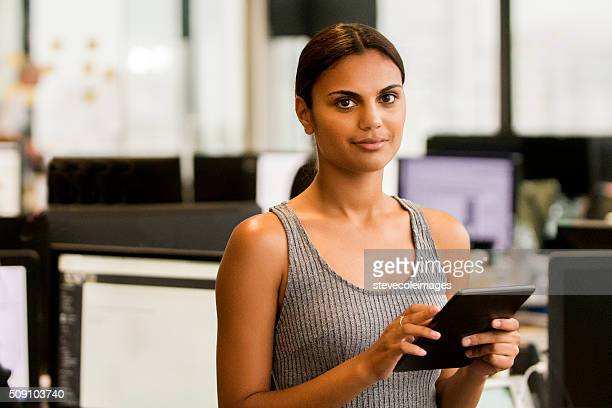 Young businesswoman holding digital tablet.