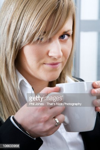 Young businesswoman holding mug : Stock Photo