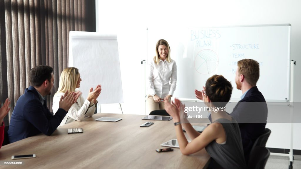 Young businesswoman holding presentation : Photo