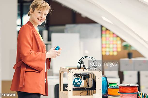 Young Businesswoman in 3D Printing Office.