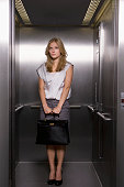 Young Businesswoman in Elevator
