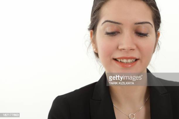 Young Businesswoman looking down and smiling