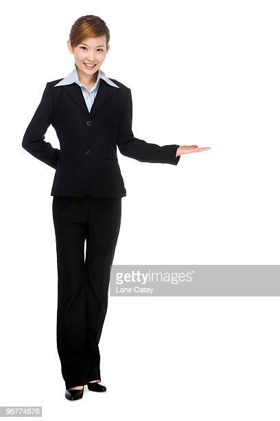 Young businesswoman making a welcoming gesture