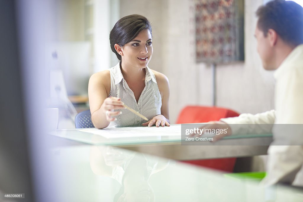 Young businesswoman meeting client in office