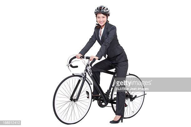 Young businesswoman on a bike