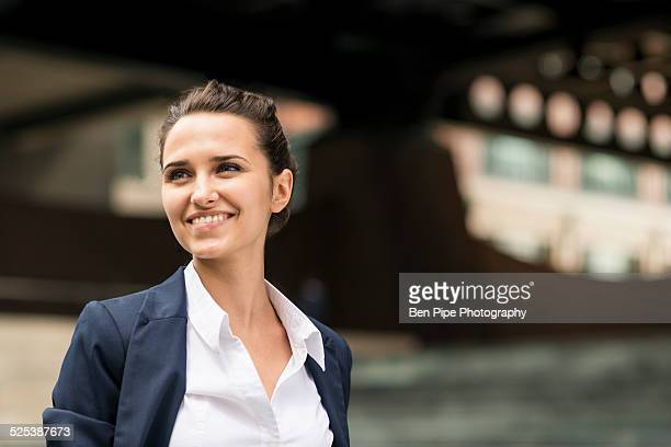 Young businesswoman outside station with digital tablet, London, UK