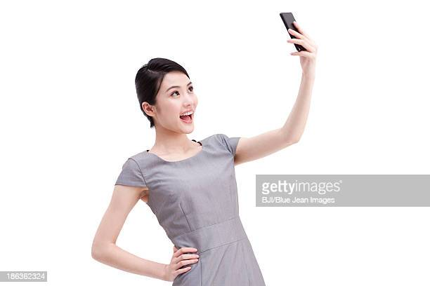 Young businesswoman photonic with mobile phone