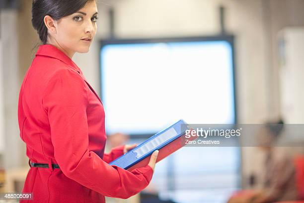 Young businesswoman preparing for meeting in office