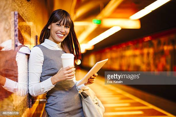Young businesswoman reading news