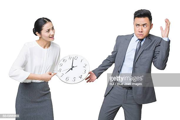 Young businesswoman scolding businessman
