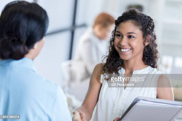 Young businesswoman shakes hands before interview