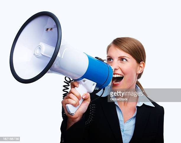 Young businesswoman shouting into a megaphone