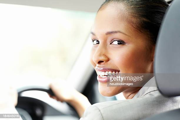 Young Businesswoman Smiling in the Car