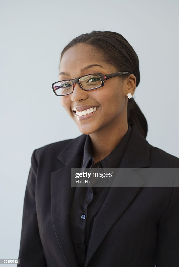 Young businesswoman smiling, portrait, close-up : Stock Photo