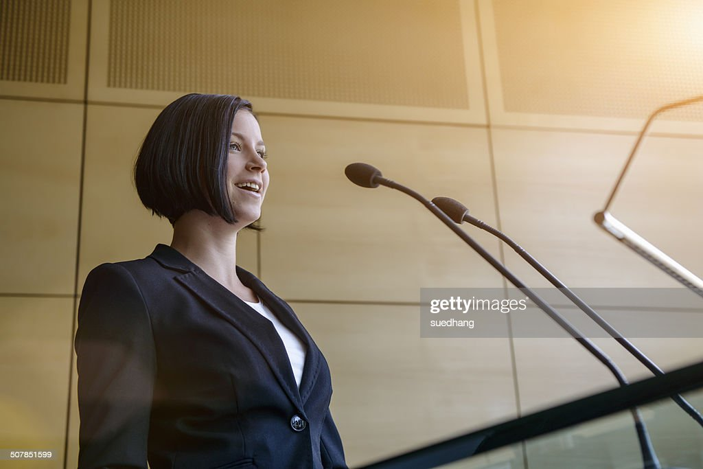 Young businesswoman speaking in conference room
