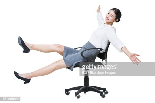 Young businesswoman stretching on chair