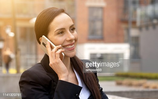 Young businesswoman talking on the phone : Stock Photo