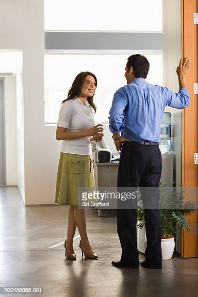 Young businesswoman talking to male colleague