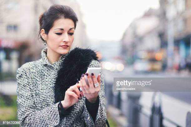 Young businesswoman texting