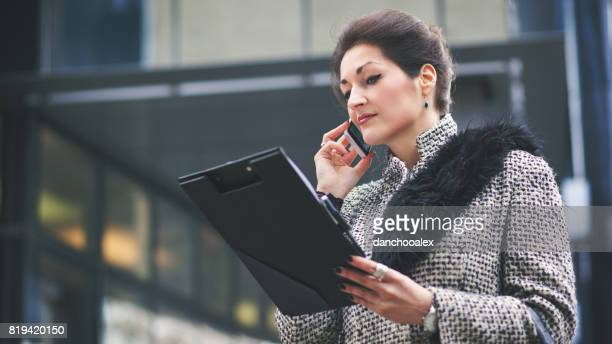 Young businesswoman using smart phone outdoors