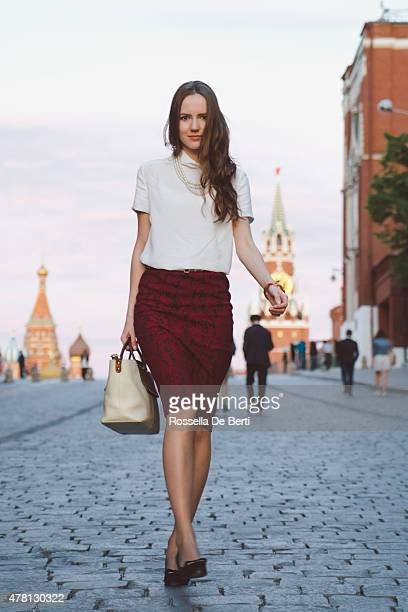 Young Businesswoman Walking In A City Street