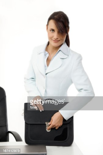 Young businesswoman with briefcase : Stock Photo