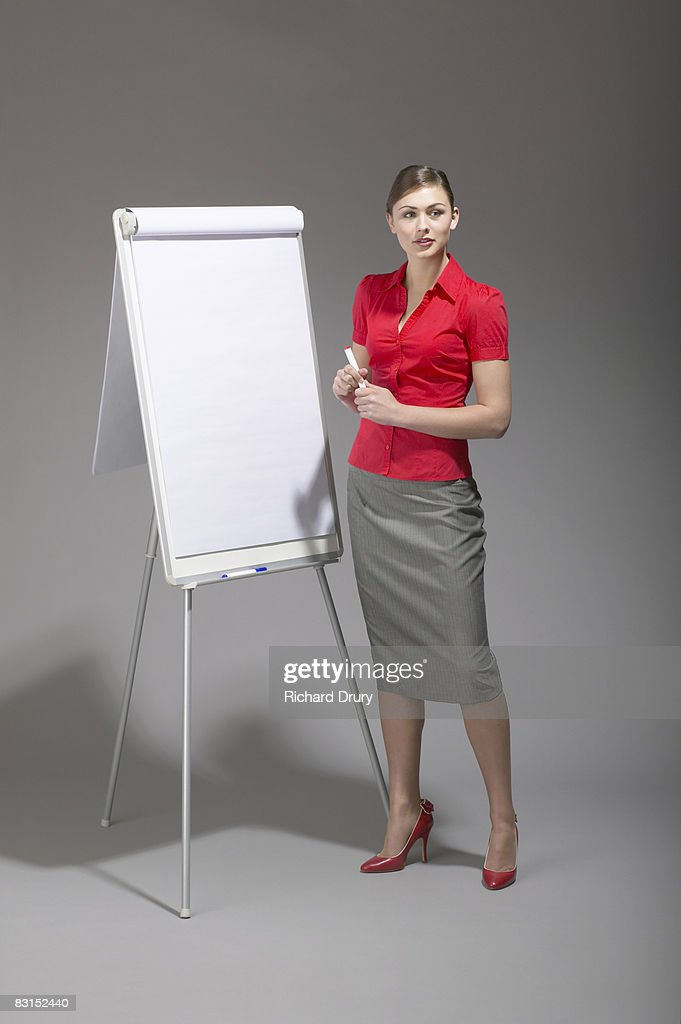 Young businesswoman with flipchart : Stock Photo