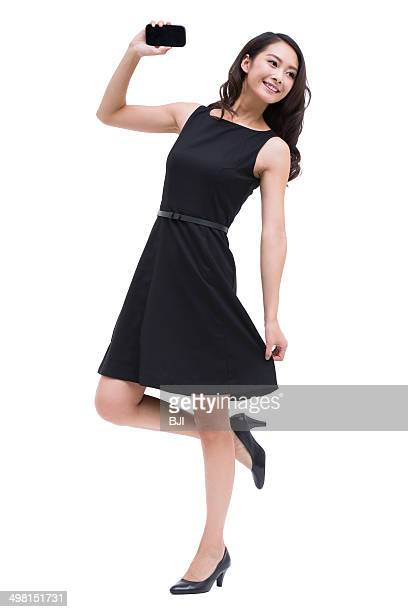 Young businesswoman with smart phone