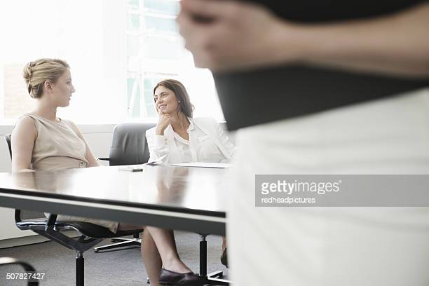 Young businesswomen meeting in conference room