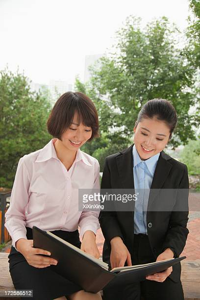 Young businesswomen working outdoors