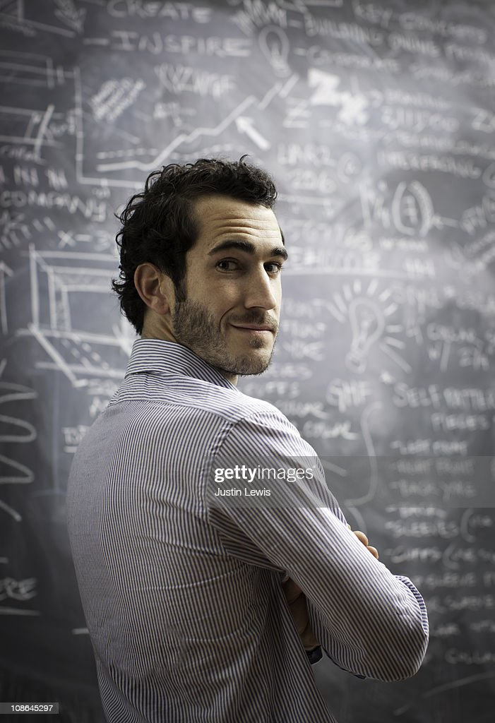 Young bussiness male after using chalkboard : Stock Photo