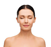 health, spa, people and beauty concept - clean face of beautiful young woman with closed eyes