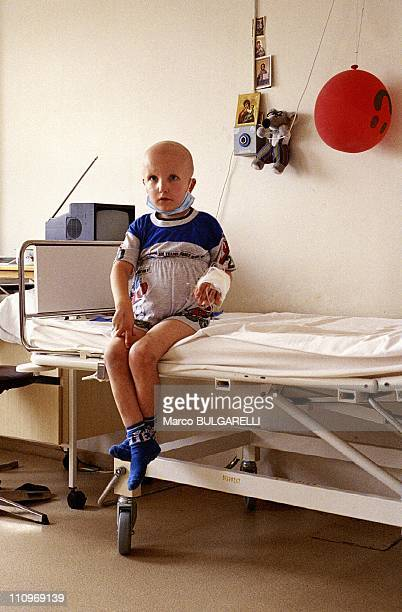 A young cancer victim of the Chernobyl disaster sits on a bed at a hospital in September 2004 in Minsk Belarus Next month sees the 25th anniversary...