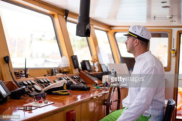 Young captain steering boat