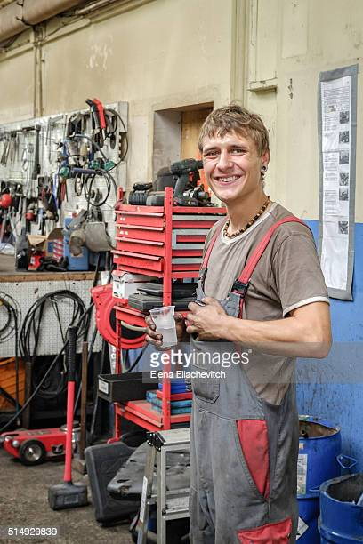 Young car mechanic in auto repair shop
