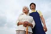 A Young Care Worker and A Senior Adult Woman Standing